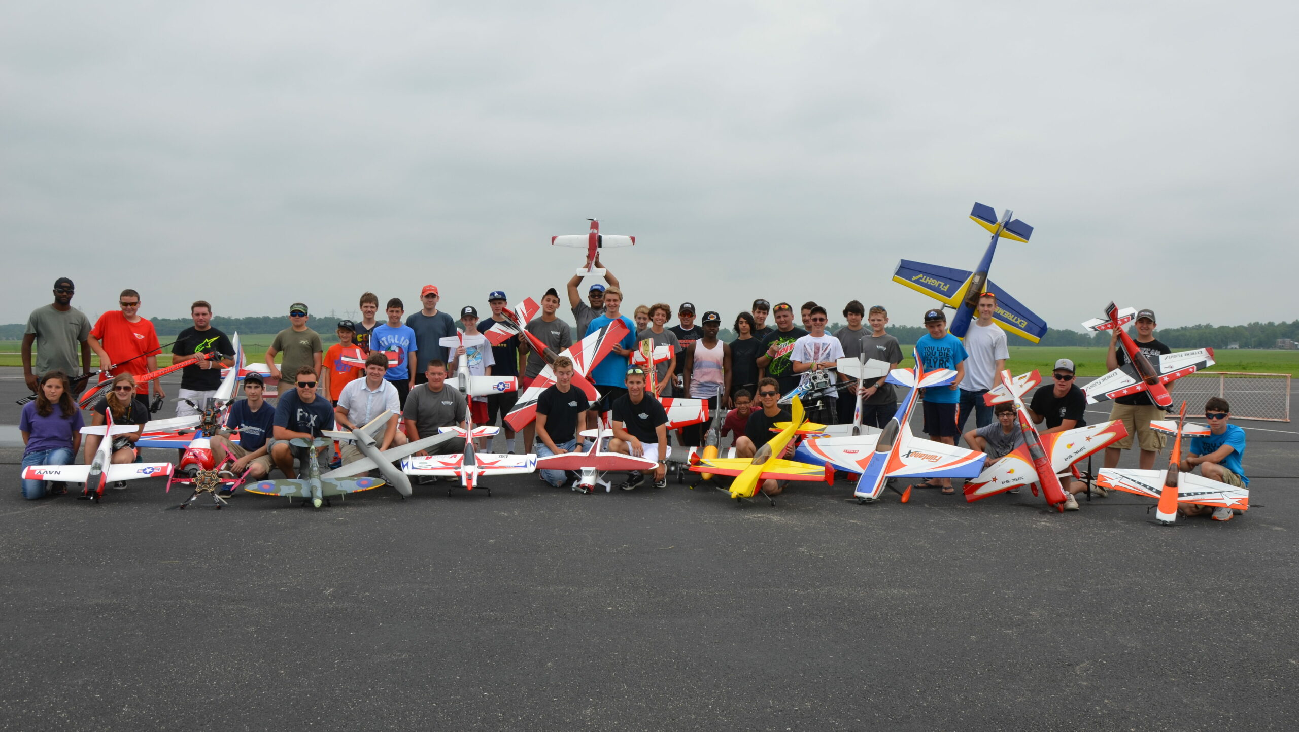 A group of campers and their model airplanes