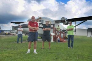 Volunteers Roy Wilson, from Mays Landing, left, Ron Frantz, George Lods, Dick Goldstine and Tim Jacobsen, all from Millville, pose in front of one of the vintage aircraft they are restoring at the Millville Army Air Museum