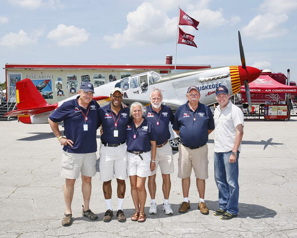 The Red Tail Team - Doug Rozendaal, Brad Lang, Jeanette Hollis, Terry Hollis, Ken Mist, and Kevin Sutterfield. Photo courtesy Don Bok — at New Smyrna Beach Municipal Airport.
