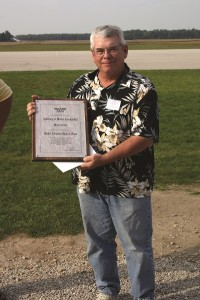 Mike receiving his AMA Model Aviation Hall of Fame plaque in 2008. Photo by Stan Alexander.